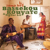 Cover: Bassekou Kouyate, Ngoni Ba und Band in einem Zimmer; Out Here