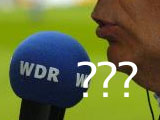 Ausschnitt eines Gesichts und ein Mikrofon mit der Aufschrift &amp;quot;WDR&amp;quot;; Rechte: dpa