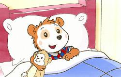 Bobo Siebenschläfer aus der 'Sendung mit dem Elefanten' ist früh morgens aufgewacht und liegt gut gelaunt mit seinem Kuscheltieräffchen im Bett.  (Bildrechte: WDR)